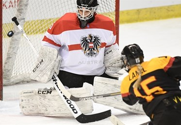 Andrea Lanzl scores in the first period on Saturday in Germany's 4-1 win over Austria in the Final Olympic Qualification Group D. Seinosuke Uchigasaki.